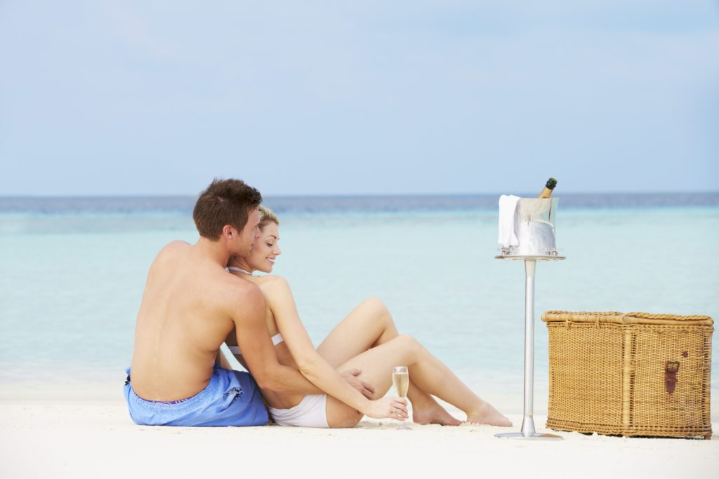 Luxury Travel Experience couple goals on Beach With Luxury Champagne celebrating Honeymoon