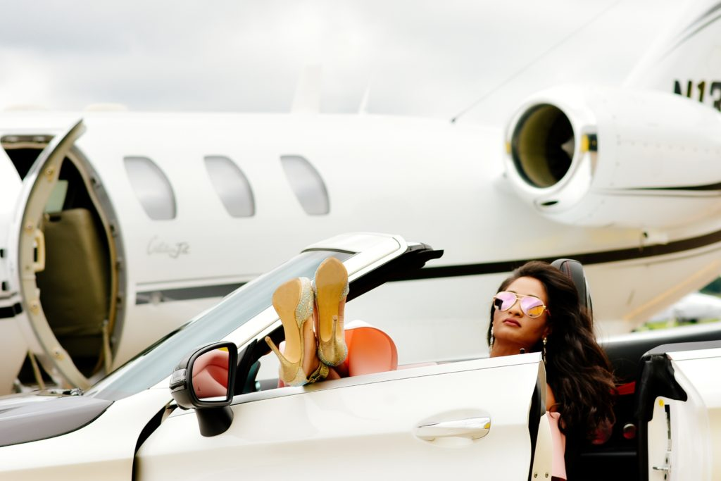 Private Jet Charter Flight Boss Lady in Luxury Car