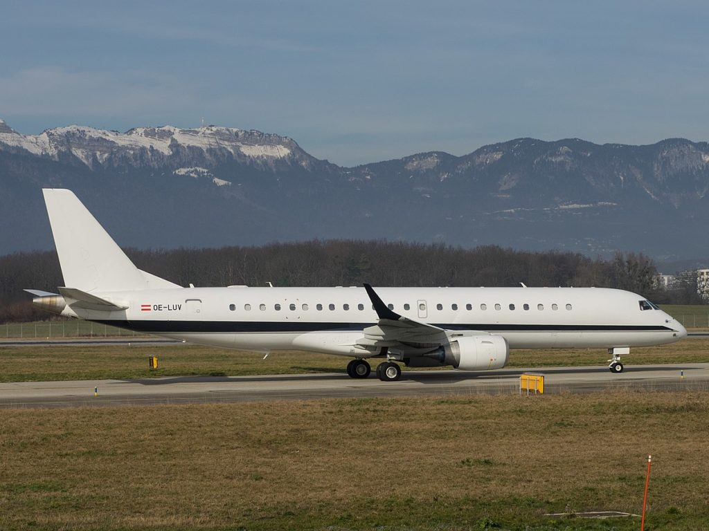 Embraer Lineage 1000E private jet is landed near beautiful mountains