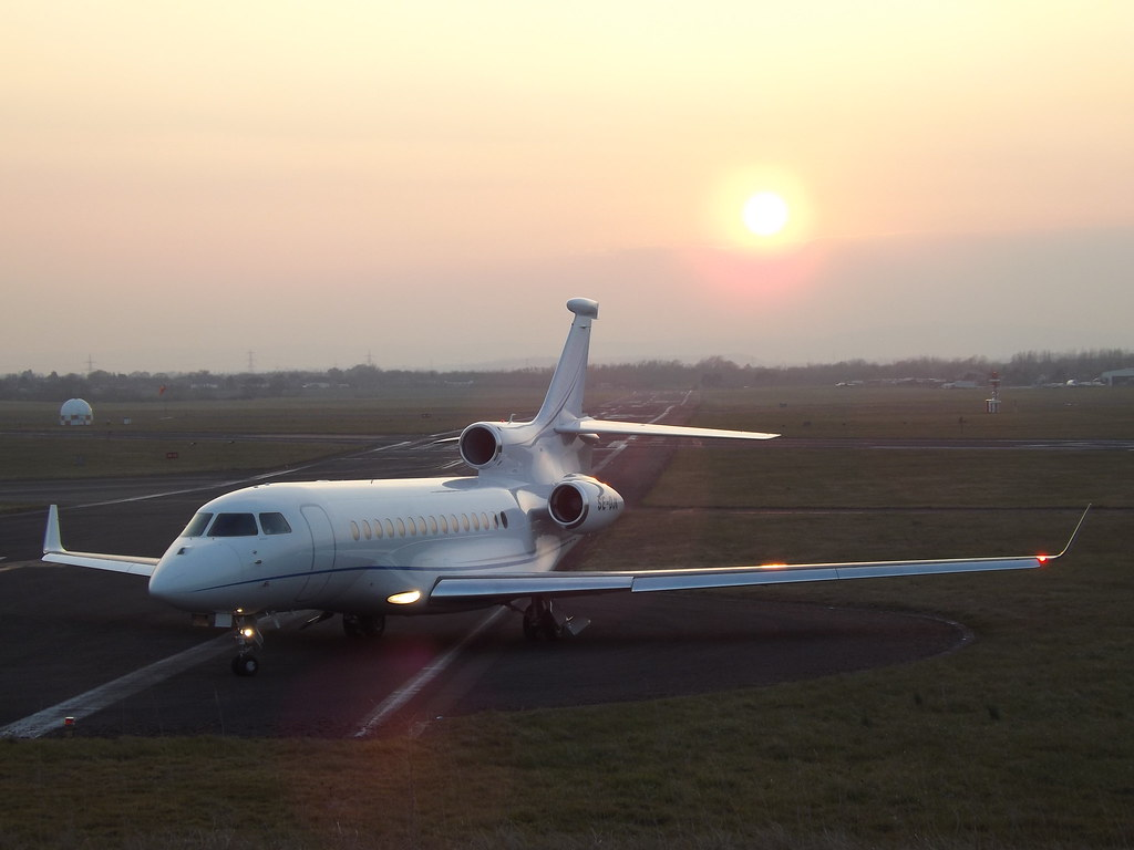 Private jet Dassault Falcon 7X  looking beautiful in sunset